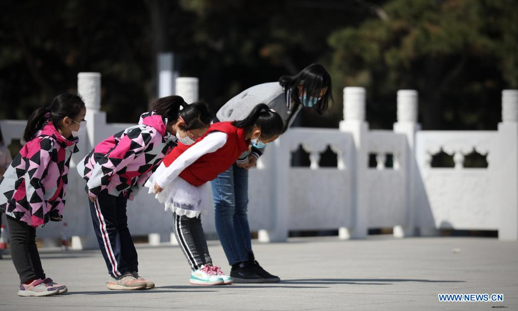 People bow to the monument at the Chinese People's Volunteers (CPV) martyrs' cemetery in Shenyang, capital of northeast China's Liaoning Province, April 4, 2021. A commemoration activity was held here on Sunday to pay tribute to martyrs on the occasion of Tomb-Sweeping Day. (Xinhua/Yao Jianfeng)