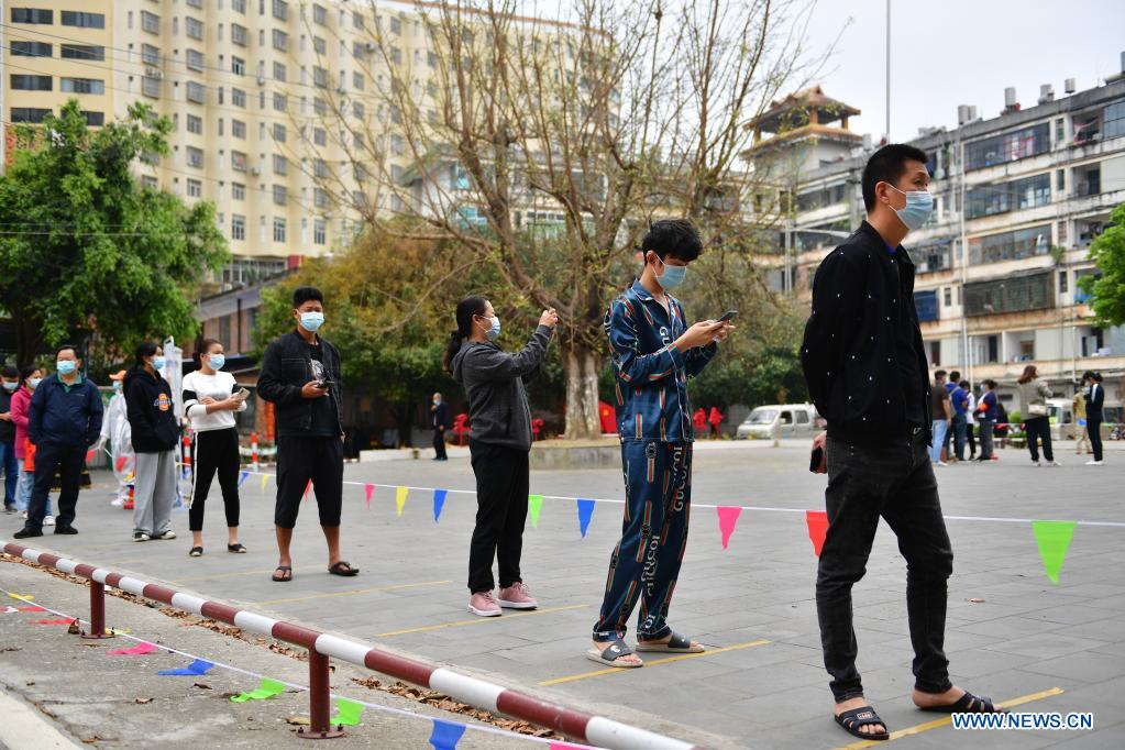 Residents wait in line to receive nucleic acid testing for COVID-19 at Youyi community, Ruili City, southwest China's Yunnan Province, April 6, 2021. Ruili City in southwest China's Yunnan Province on Tuesday launched the second round of nucleic acid testing that includes all residents of the city proper. (Xinhua/Chen Xinbo)
