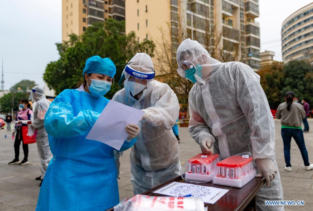 Medical workers verify sample information to be used in nucleic acid testing for COVID-19 at Youyi community, Ruili City, southwest China's Yunnan Province, April 6, 2021. Ruili City in southwest China's Yunnan Province on Tuesday launched the second round of nucleic acid testing that includes all residents of the city proper. (Xinhua/Chen Xinbo)