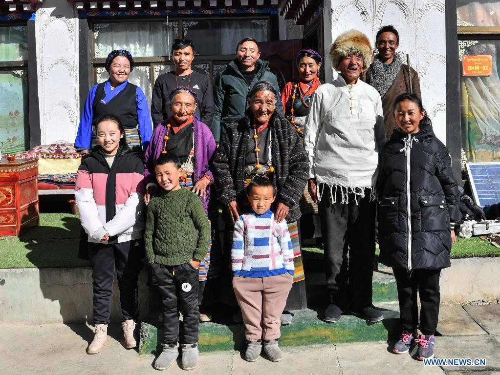 Dacho (C) poses for a photo with her family members at home in Lalho Township, Saga County of Xigaze, southwest China's Tibet Autonomous Region, Jan. 14, 2021. Dacho, born in 1929, is a resident in Lalho Township, Saga County of Xigaze, southwest China's Tibet Autonomous Region. She was made a serf in her early childhood and had suffered an unimaginable ordeal until the democratic reform in 1959.