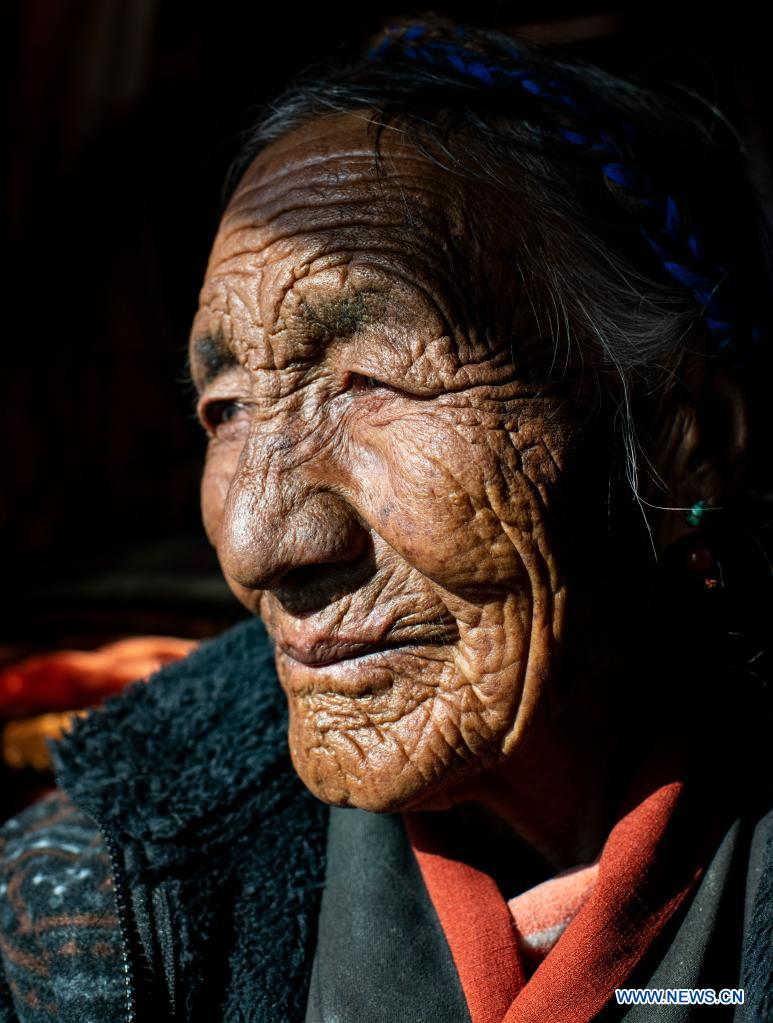Photo taken on Jan. 14, 2021 shows a portrait of Dacho in Lalho Township, Saga County of Xigaze, southwest China's Tibet Autonomous Region. Dacho, born in 1929, is a resident in Lalho Township, Saga County of Xigaze, southwest China's Tibet Autonomous Region. She was made a serf in her early childhood and had suffered an unimaginable ordeal until the democratic reform in 1959.