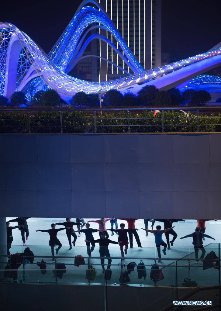 People exercise at a plaza in Wuhan, central China's Hubei Province, April 2, 2021. Wuhan, once hit hard by COVID-19, has seen its urban life at night return to normal since its lockdown was lifted on April 8, 2020. (Photo by Wu Zhizun/Xinhua)