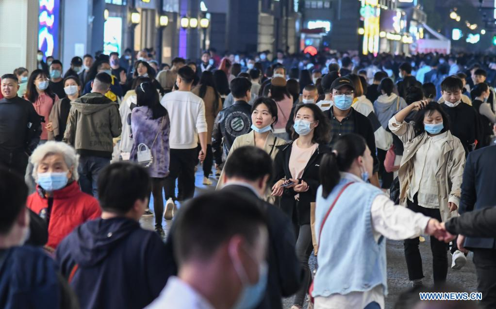 People walk on a commercial street in Wuhan, central China's Hubei Province, March 29, 2021. Wuhan, once hit hard by COVID-19, has seen its urban life at night return to normal since its lockdown was lifted on April 8, 2020. (Xinhua/Cheng Min)
