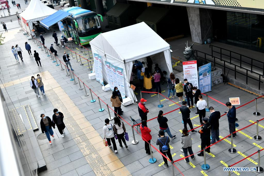 Residents line up to receive COVID-19 vaccines at a mobile COVID-19 vaccination site near Xidan business area in downtown Beijing, capital of China, April 7, 2021. Since April 1, Beijing has started to use mobile COVID-19 vaccination vehicles in its four districts to expedite vaccination. The vehicles are equipped with facilities such as computers, refrigerators and air conditioners to ensure the convenience, safety and reliability during the vaccination process. Technologies such as 5G and big data are also employed to manage vaccination with digital means and ensure the traceability of the whole process. (Xinhua/Li Xin)