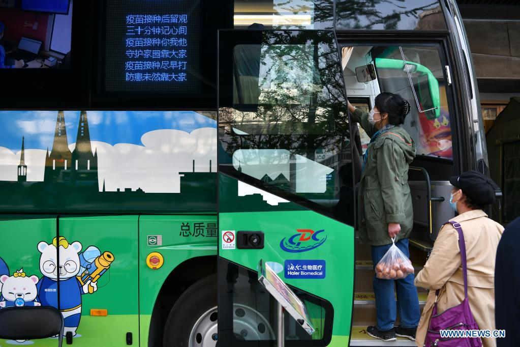 Residents wait to receive COVID-19 vaccines in a mobile COVID-19 vaccination vehicle near Xidan business area in downtown Beijing, capital of China, April 7, 2021. Since April 1, Beijing has started to use mobile COVID-19 vaccination vehicles in its four districts to expedite vaccination. The vehicles are equipped with facilities such as computers, refrigerators and air conditioners to ensure the convenience, safety and reliability during the vaccination process. Technologies such as 5G and big data are also employed to manage vaccination with digital means and ensure the traceability of the whole process. (Xinhua/Li Xin)