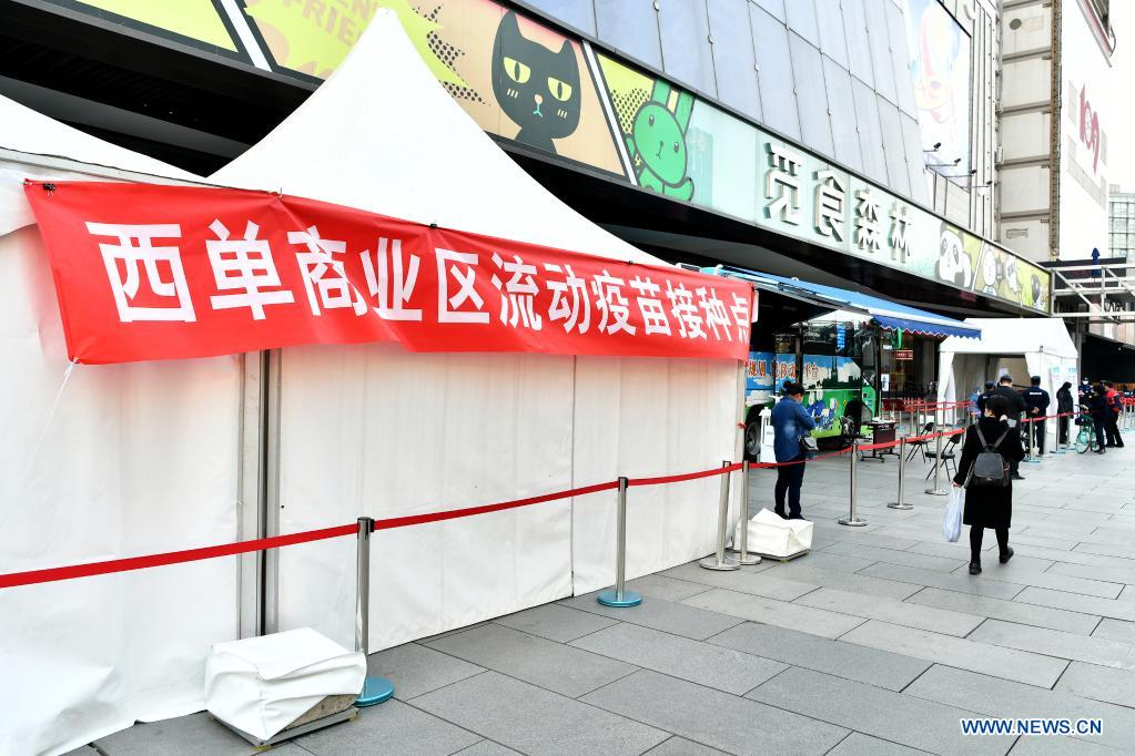 Photo taken on April 7, 2021 shows a mobile COVID-19 vaccination site near Xidan business area in downtown Beijing, capital of China. Since April 1, Beijing has started to use mobile COVID-19 vaccination vehicles in its four districts to expedite vaccination. The vehicles are equipped with facilities such as computers, refrigerators and air conditioners to ensure the convenience, safety and reliability during the vaccination process. Technologies such as 5G and big data are also employed to manage vaccination with digital means and ensure the traceability of the whole process. (Xinhua/Li Xin)