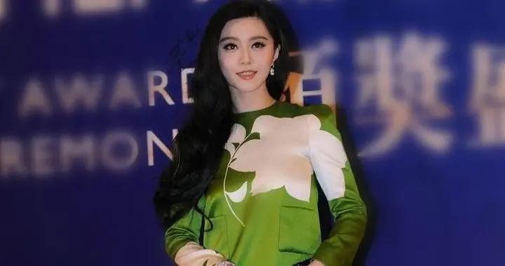 范冰冰依然国际范十足,穿一袭绿色印花连衣裙高贵优雅,漂亮大气