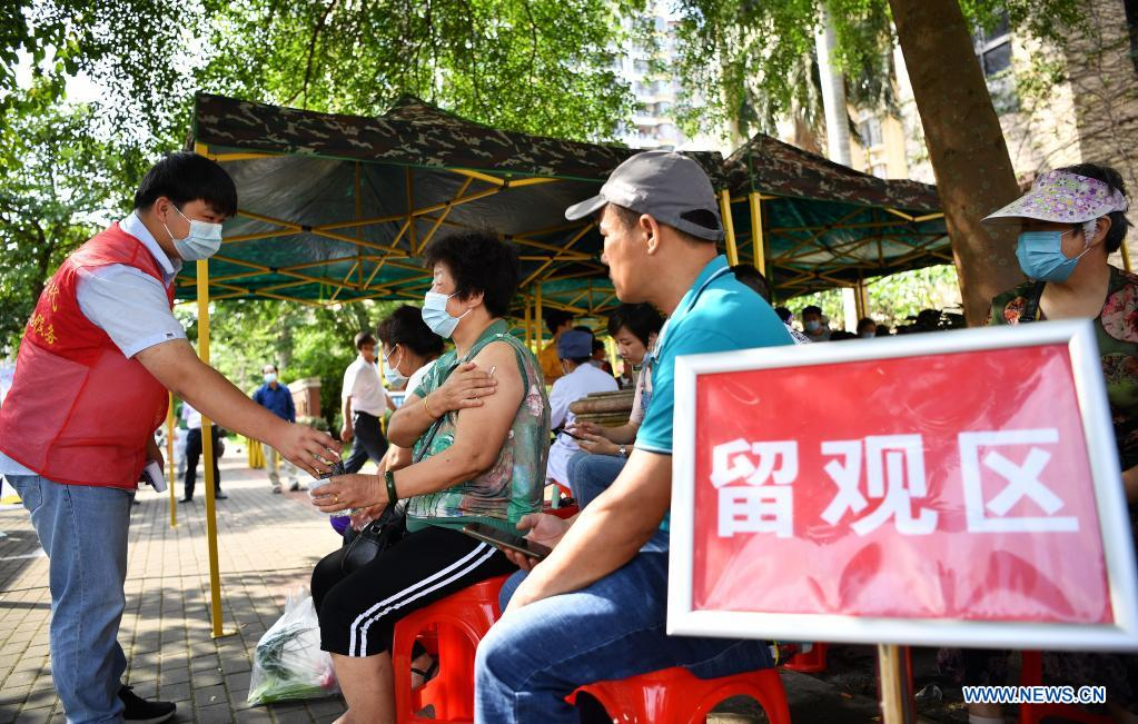 Recipients of COVID-19 vaccines wait in a post-vaccination observation zone near a mobile vaccination station in Qiongshan District of Haikou, south China's Hainan Province, April 15, 2021. Vaccination against COVID-19 has been made easier for Haikou residents as 20 bus-turned mobile vaccination stations were recently introduced at the service of vaccine recipients in need. (Xinhua/Guo Cheng)