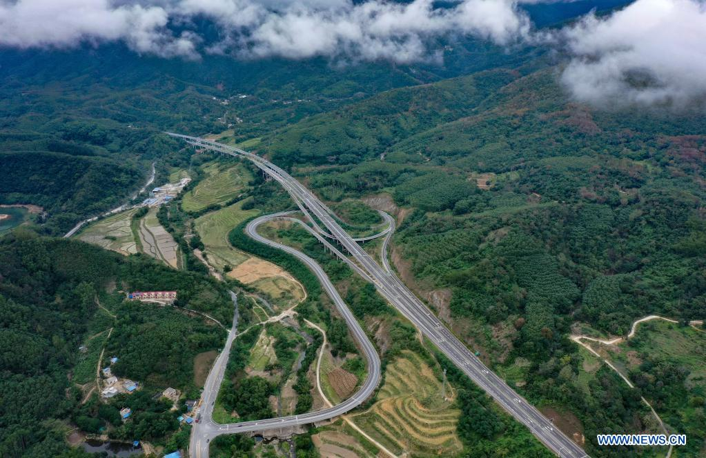 Aerial photo taken on Dec. 12, 2020 shows a view of a section of Haikou-Sanya Expressway in south China's Hainan Province. Hainan has made significant progress in the construction of expressway since the 13th Five-Year Plan, which started in 2016. By far, the total mileage of expressways in the province has reached 1,255 kilometers. The transport upgrade will help boost the building of Hainan into an international tourism and consumption center. (Xinhua/Guo Cheng)