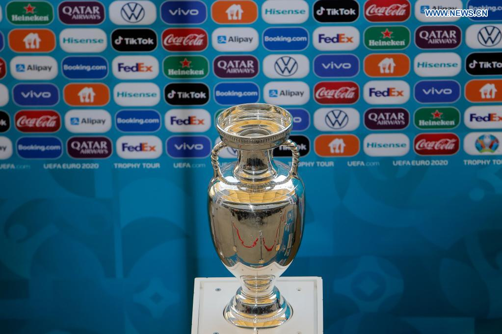 The EURO 2020 soccer tournament trophy is seen during a presentation in Bucharest, Romania, April 25, 2021. The EURO 2020 soccer tournament was postponed to 2021 due to COVID-19 pandemic. Bucharest will host three matches of Group C and one from the round of 16 at the National Arena. (Photo by Cristian Cristel/Xinhua)