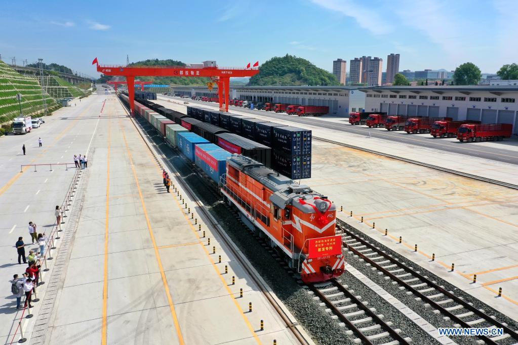 Aerial photo taken on April 30, 2021 shows the first freight train leaving Dulaying international land-sea logistics port in Guiyang City of southwest China's Guizhou Province. Dulaying international land-sea logistics port in Guiyang officially opened on Friday. Its construction was divided into two phases and the first phase project has been accepted in January this year. After completion, the annual cargo transport capacity of the first phase project is expected to reach 5 million tons. (Xinhua/Liu Xu)