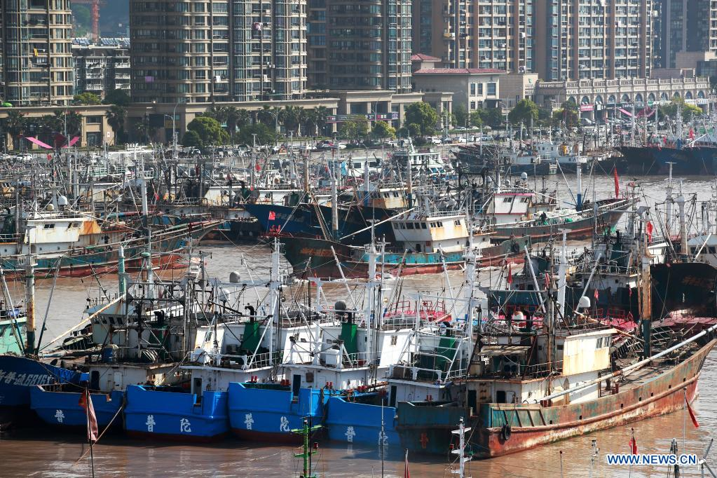 Photo taken on April 30, 2021 shows fishing vessels berthed at Shenjiamen port in Putuo District of Zhoushan City, east China's Zhejiang Province. The annual summer fishing ban, covering the Bohai Sea, the Yellow Sea, the East China Sea, and the waters north to 12 degrees north latitude of the South China Sea, started Saturday. (Photo by Yao Feng/Xinhua)