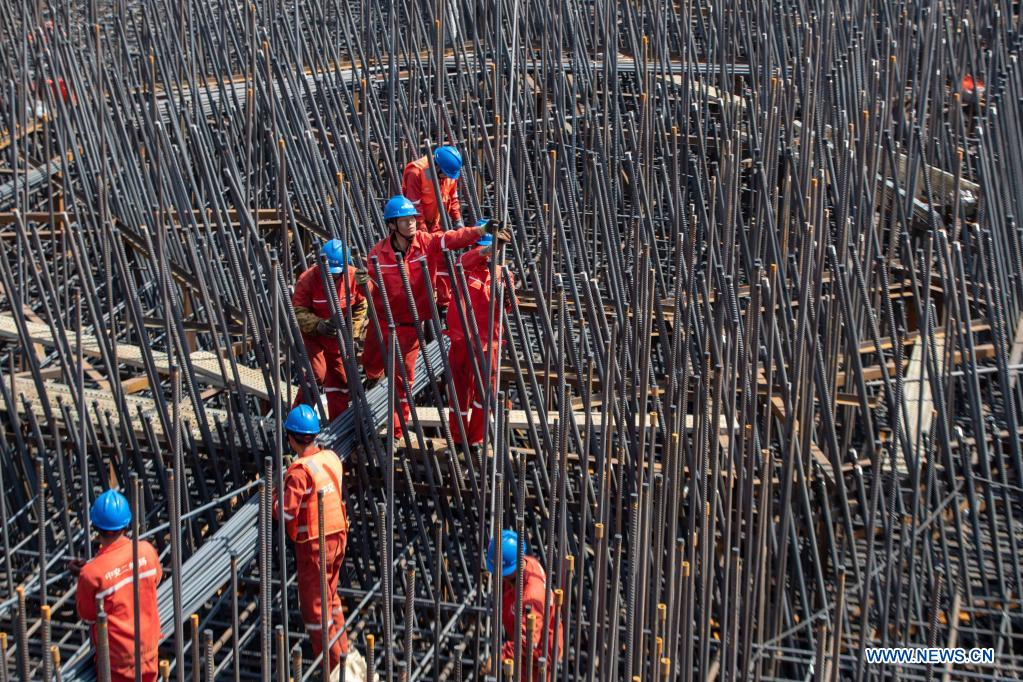 Workers are busy at the construction site of a bridge on the Yangtze River linking Changzhou and Taizhou in east China's Jiangsu Province, May 1, 2021. People from various sectors stick to their posts during the Labor Day holiday. (Photo by Tang Dehong/Xinhua)