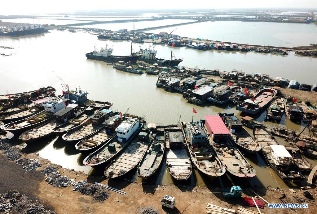 Aerial photo taken on April 30, 2021 shows fishing vessels berthed at a port in Ganyu District of Lianyungang, east China's Jiangsu Province. The annual summer fishing ban, covering the Bohai Sea, the Yellow Sea, the East China Sea, and the waters north to 12 degrees north latitude of the South China Sea, started Saturday. (Photo by Geng Yuhe/Xinhua)
