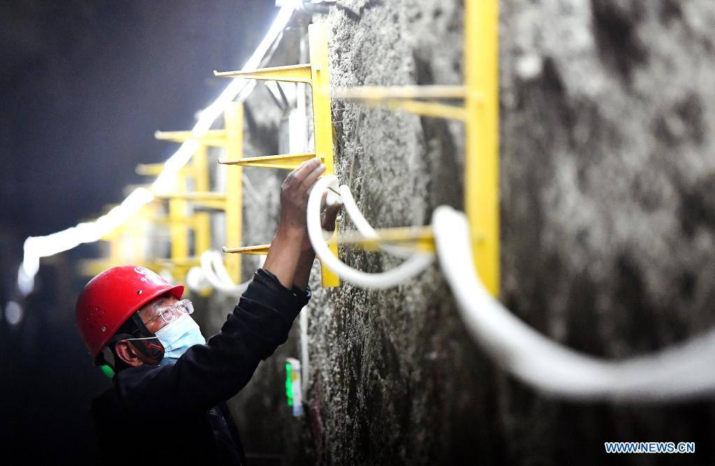 A worker from China Railway Seventh Group Co., Ltd. works at the construction site of a railway station of Xi'an Subway Line 8 in Xi'an City, capital of northwest China's Shaanxi Province, May 1, 2021. People from various sectors stick to their posts during the Labor Day holiday. (Xinhua/Liu Xiao)