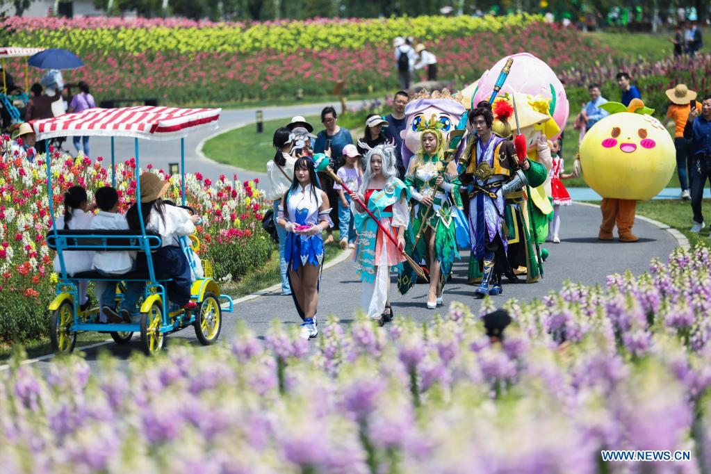 Cartoon characters and cosplayers parade in the flower fields in Jingshan Township of Yuhang District in Hangzhou, capital of east China's Zhejiang Province, May 2, 2021. From May 1 to May 5, an animation carnival is held at the flower fields at the Jingshan Town of Yuhang District of Hangzhou. (Xinhua/Xu Yu)