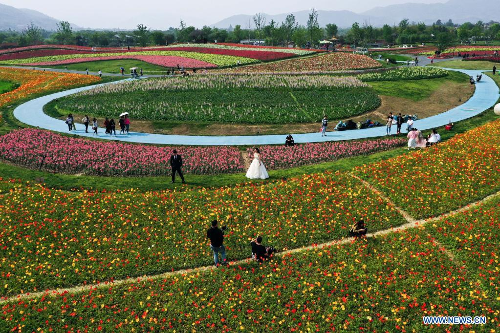 People visit the flower fields in Jingshan Township of Yuhang District in Hangzhou, capital of east China's Zhejiang Province, May 2, 2021. From May 1 to May 5, an animation carnival is held at the flower fields at the Jingshan Town of Yuhang District of Hangzhou. (Xinhua/Xu Yu)