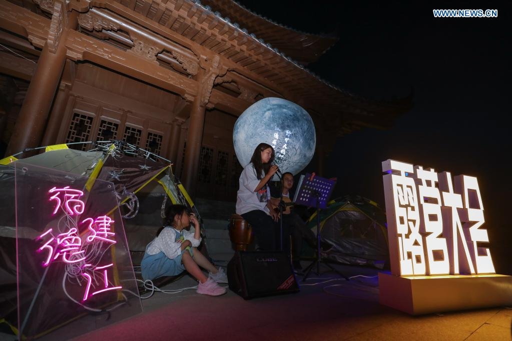 Visitors participate in a camping event in Yanzhou ancient city in Meicheng Township, Jiande City of east China's Zhejiang Province, on May 2, 2021. The ancient city received a total of 114,000 visitors on Saturday and Sunday. (Xinhua/Xu Yu)