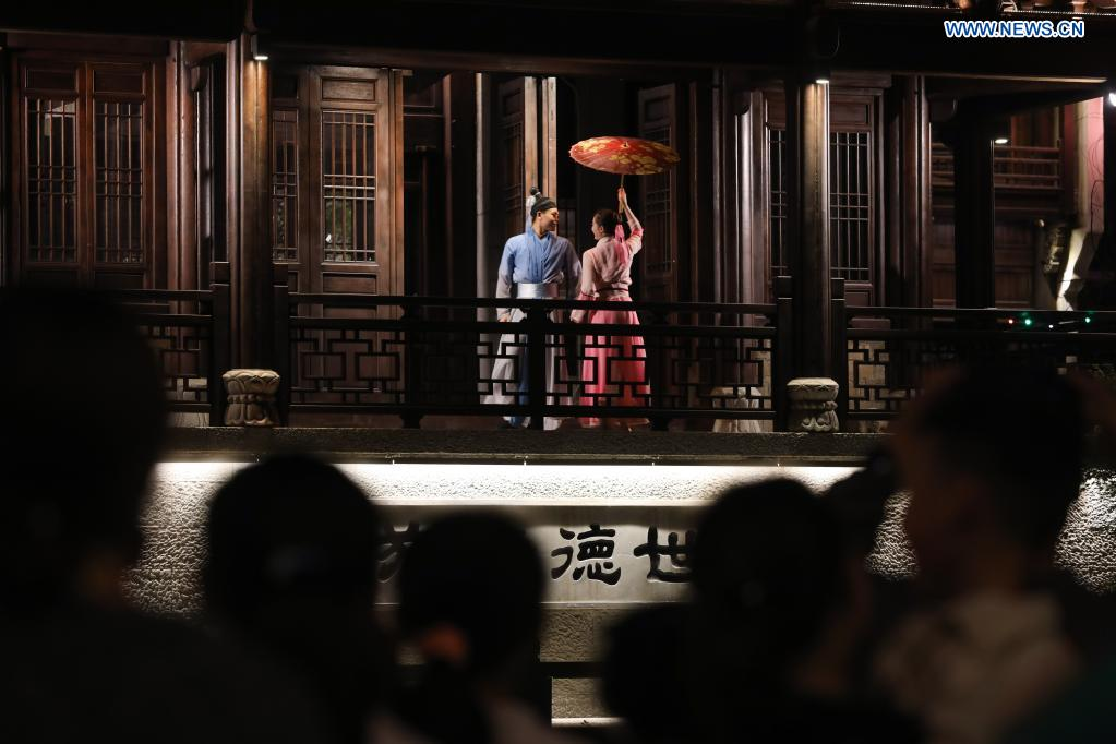 Visitors watch a night performance in Yanzhou ancient city in Meicheng Township, Jiande City of east China's Zhejiang Province, on May 2, 2021. The ancient city received a total of 114,000 visitors on Saturday and Sunday. (Xinhua/Xu Yu)