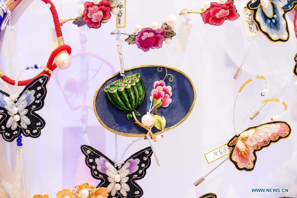 Photo taken on May 10, 2021 shows embroidered brooches on display during the first China International Consumer Products Expo in Haikou, capital of south China's Hainan Province. Domestic exhibits with Chinese characteristics are quite a sight at the Expo, not only meeting the needs of consumers, but also reflecting the unique charm of Chinese culture. (Xinhua/Zhou Jiayi)