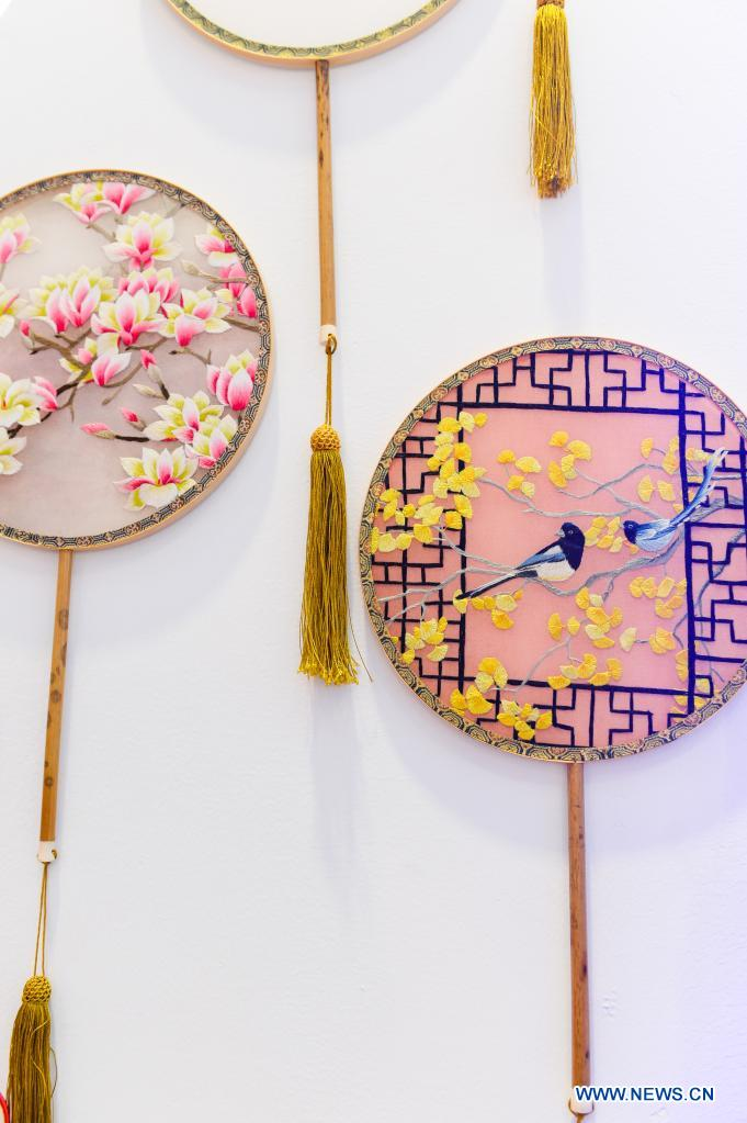 Photo taken on May 10, 2021 shows embroidered fans on display during the first China International Consumer Products Expo in Haikou, capital of south China's Hainan Province. Domestic exhibits with Chinese characteristics are quite a sight at the Expo, not only meeting the needs of consumers, but also reflecting the unique charm of Chinese culture. (Xinhua/Zhou Jiayi)