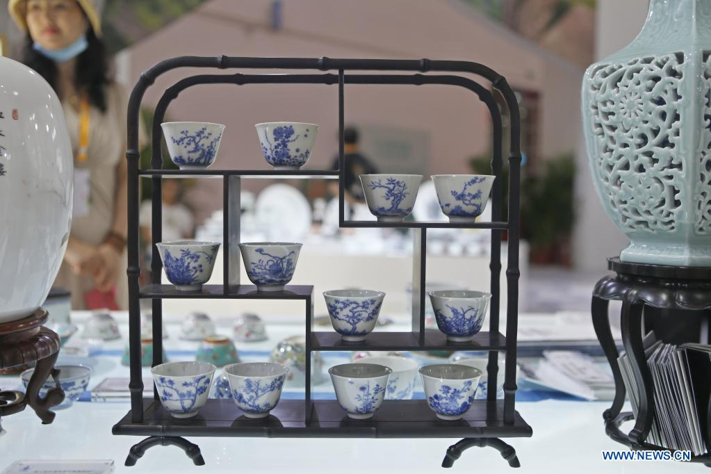 Photo taken on May 9, 2021 shows a set of porcelain cups on display during the first China International Consumer Products Expo in Haikou, capital of south China's Hainan Province. Domestic exhibits with Chinese characteristics are quite a sight at the Expo, not only meeting the needs of consumers, but also reflecting the unique charm of Chinese culture. (Xinhua/Ding Hongfa)