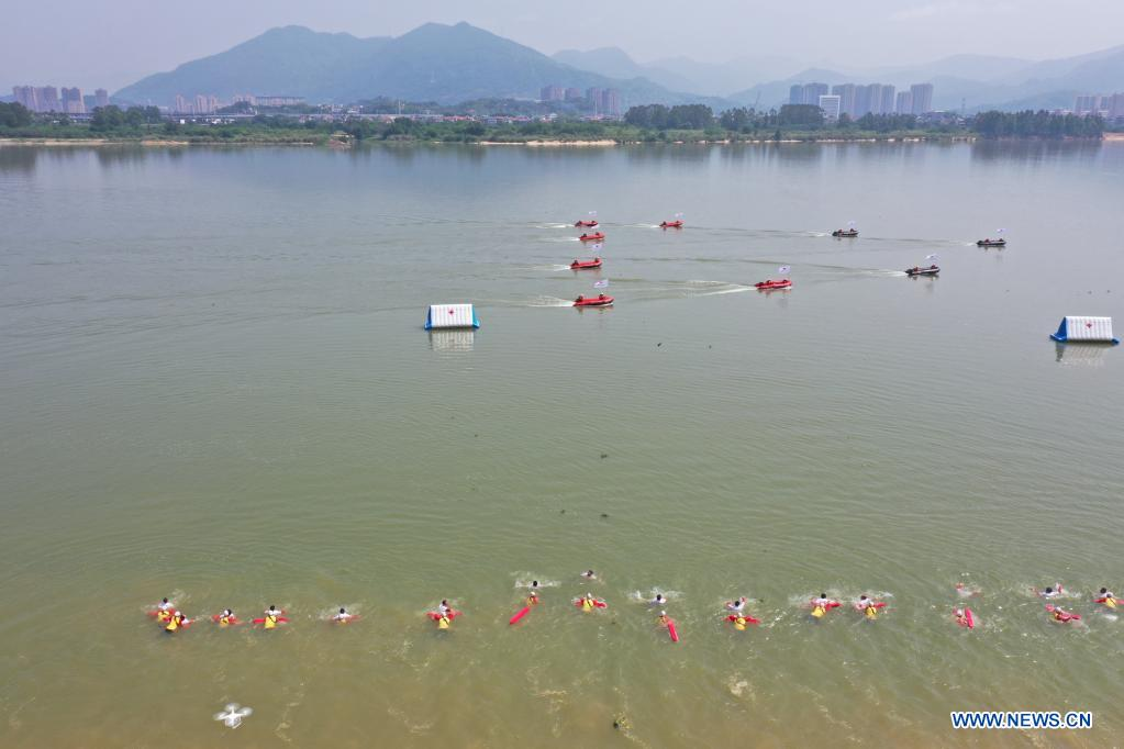 Aerial photo taken on May 10, 2021 shows rescue teams participating in an emergency rescue drill in Fuzhou, capital of southeast China's Fujian Province. A comprehensive emergency rescue drill hosted by the Red Cross Society of China was held in Fuzhou on Monday. A total of 13 Red Cross rescue teams from all over the country and the Donghai No.2 flying rescue service participated in the drill and systematically exercised rescue subjects like aquatic lifesaving, search and rescue, medical treatment, water supply and etc., in an effort to improve the joint rescue capability of various rescue teams at different levels. (Xinhua/Jiang Kehong)