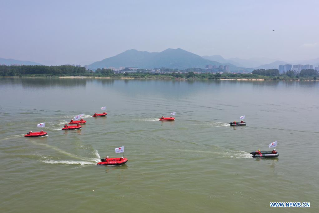 Aerial photo taken on May 10, 2021 shows Red Cross rescue teams participating in a search and rescue exercise during an emergency rescue drill in Fuzhou, capital of southeast China's Fujian Province. A comprehensive emergency rescue drill hosted by the Red Cross Society of China was held in Fuzhou on Monday. A total of 13 Red Cross rescue teams from all over the country and the Donghai No.2 flying rescue service participated in the drill and systematically exercised rescue subjects like aquatic lifesaving, search and rescue, medical treatment, water supply and etc., in an effort to improve the joint rescue capability of various rescue teams at different levels. (Xinhua/Jiang Kehong)