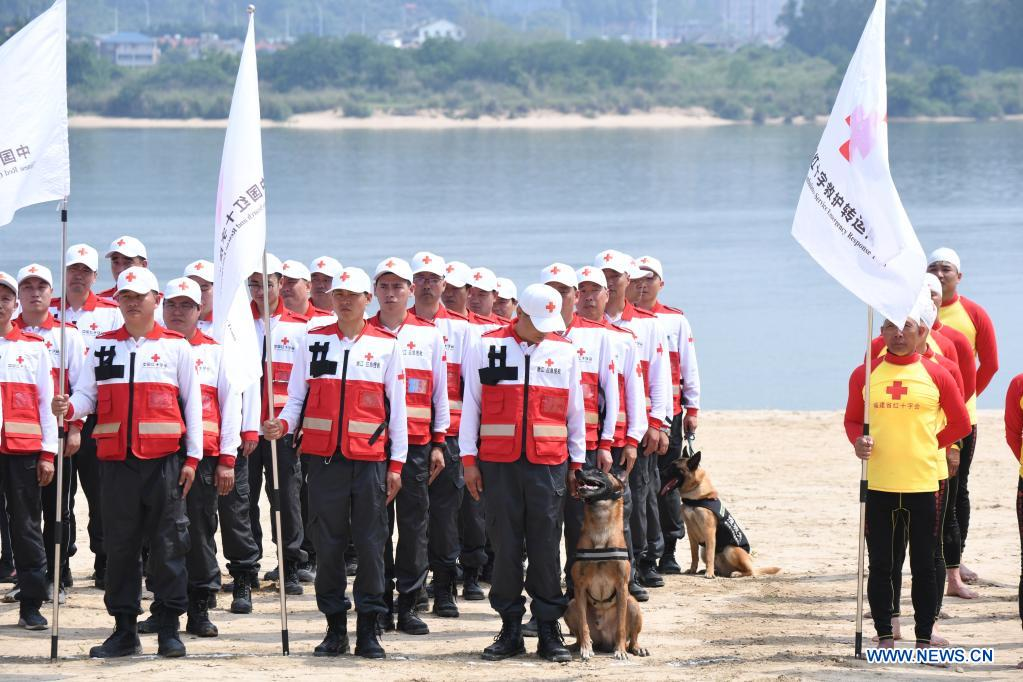 Rescuers assemble at the opening ceremony of an emergency rescue drill in Fuzhou, capital of southeast China's Fujian Province, May 10, 2021. A comprehensive emergency rescue drill hosted by the Red Cross Society of China was held in Fuzhou on Monday. A total of 13 Red Cross rescue teams from all over the country and the Donghai No.2 flying rescue service participated in the drill and systematically exercised rescue subjects like aquatic lifesaving, search and rescue, medical treatment, water supply and etc., in an effort to improve the joint rescue capability of various rescue teams at different levels. (Xinhua/Jiang Kehong)