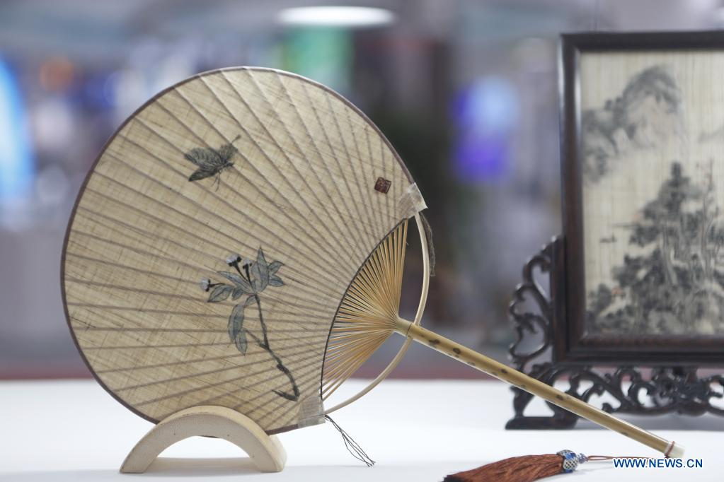 Photo taken on May 9, 2021 shows a fan made with grass linen on display during the first China International Consumer Products Expo in Haikou, capital of south China's Hainan Province. Domestic exhibits with Chinese characteristics are quite a sight at the Expo, not only meeting the needs of consumers, but also reflecting the unique charm of Chinese culture. (Xinhua/Ding Hongfa)
