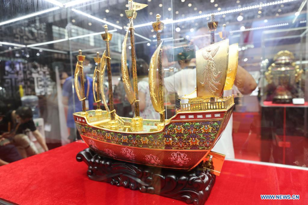 Photo taken on May 10, 2021 shows a piece of cloisonne craftwork on display during the first China International Consumer Products Expo in Haikou, capital of south China's Hainan Province. Domestic exhibits with Chinese characteristics are quite a sight at the Expo, not only meeting the needs of consumers, but also reflecting the unique charm of Chinese culture. (Xinhua/Zhang Liyun)