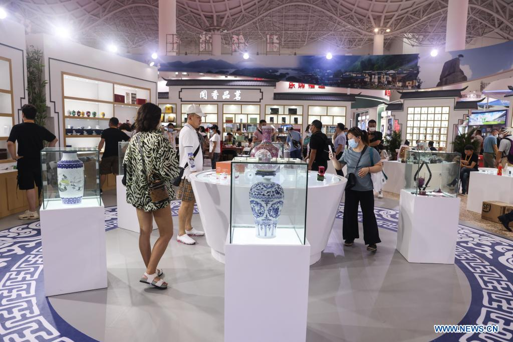 Visitors view porcelain from Jingdezhen, a world-famous