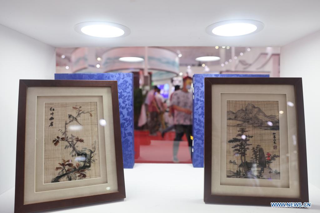 Photo taken on May 10, 2021 shows embroidery craftwork on display during the first China International Consumer Products Expo in Haikou, capital of south China's Hainan Province. Domestic exhibits with Chinese characteristics are quite a sight at the Expo, not only meeting the needs of consumers, but also reflecting the unique charm of Chinese culture. (Xinhua/Zhang Liyun)