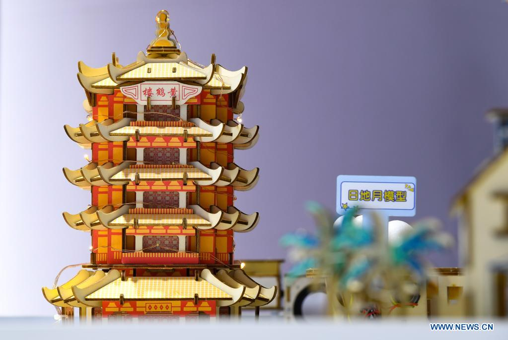 Photo taken on May 7, 2021 shows a model of Huanghelou, or Yellow Crane Tower, a landmark of the city of Wuhan, on display during the first China International Consumer Products Expo in Haikou, capital of south China's Hainan Province. Domestic exhibits with Chinese characteristics are quite a sight at the Expo, not only meeting the needs of consumers, but also reflecting the unique charm of Chinese culture. (Xinhua/Yang Guanyu)