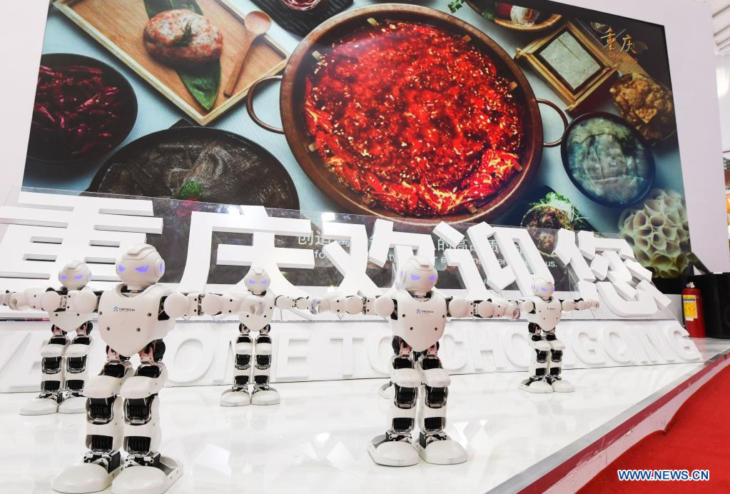 Photo taken on May 7, 2021 shows robots of brand UBTECH on display during the first China International Consumer Products Expo in Haikou, capital of south China's Hainan Province. Domestic exhibits with Chinese characteristics are quite a sight at the Expo, not only meeting the needs of consumers, but also reflecting the unique charm of Chinese culture. (Xinhua/Yang Guanyu)