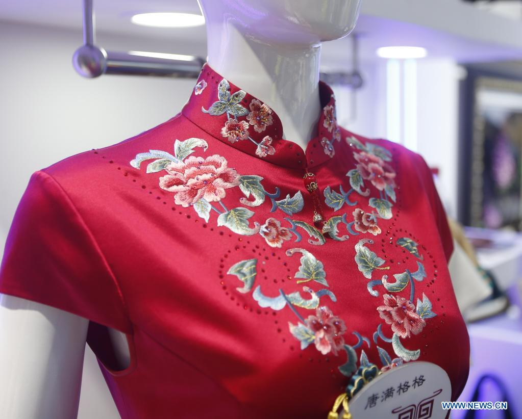 Photo taken on May 9, 2021 shows a piece of Qipao, a classic one-piece and figure-fitting Chinese dress for woman, on display during the first China International Consumer Products Expo in Haikou, capital of south China's Hainan Province. Domestic exhibits with Chinese characteristics are quite a sight at the Expo, not only meeting the needs of consumers, but also reflecting the unique charm of Chinese culture. (Xinhua/Ding Hongfa)
