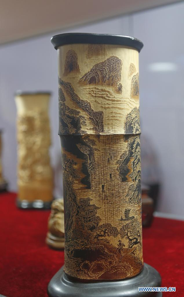 Photo taken on May 9, 2021 shows carved-bamboo pen containers on display during the first China International Consumer Products Expo in Haikou, capital of south China's Hainan Province. Domestic exhibits with Chinese characteristics are quite a sight at the Expo, not only meeting the needs of consumers, but also reflecting the unique charm of Chinese culture. (Xinhua/Ding Hongfa)