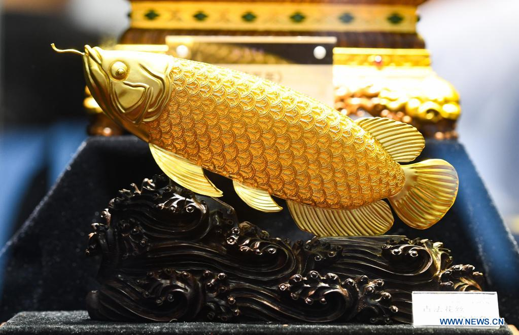 Photo taken on May 8, 2021 shows a fish decoration made with the ancient craft of filament on display during the first China International Consumer Products Expo in Haikou, capital of south China's Hainan Province. Domestic exhibits with Chinese characteristics are quite a sight at the Expo, not only meeting the needs of consumers, but also reflecting the unique charm of Chinese culture. (Xinhua/Yang Guanyu)