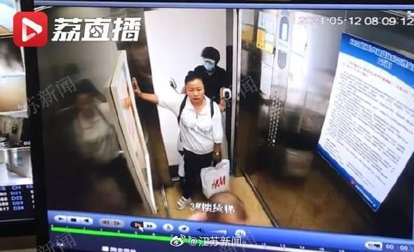 干得漂亮!女子遇电动车进电梯果断阻拦