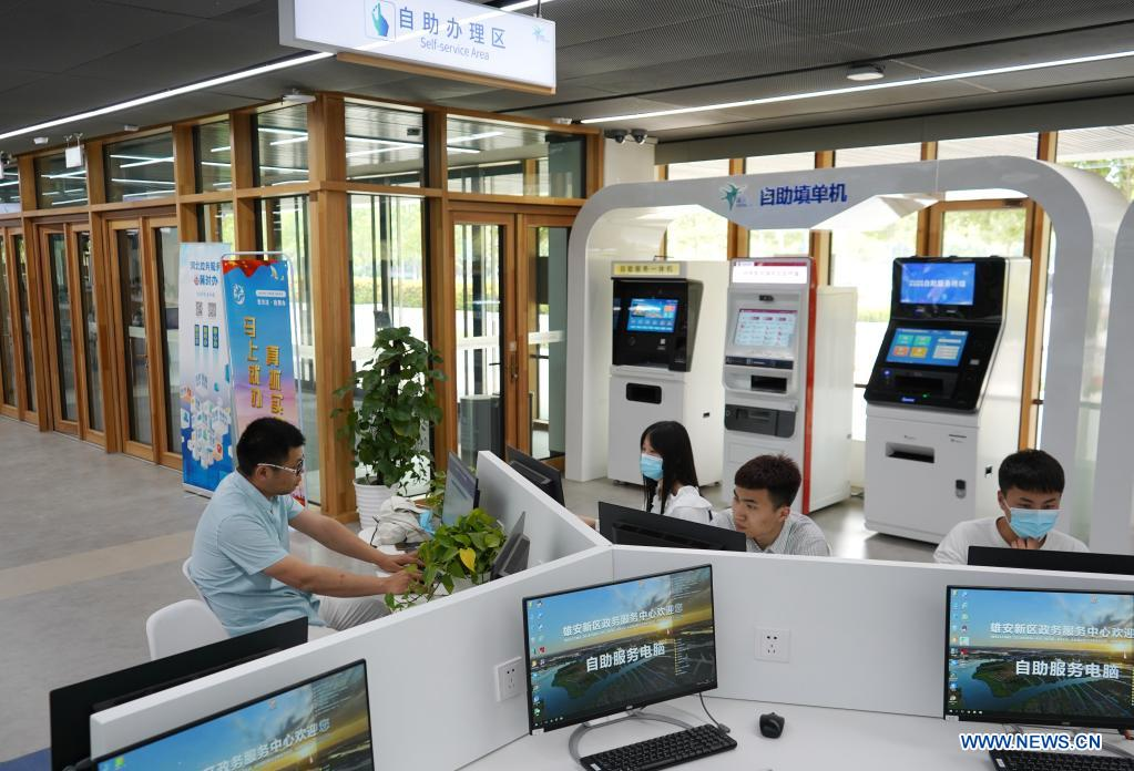 Citizens use computers at the self-service area of the Xiongan New Area Administrative Service Center in Xiongan New Area, north China's Hebei Province, May 12, 2021. Founded on May 30 of 2018 and composed of different functional areas, the Xiongan New Area Administrative Service Center acts as a