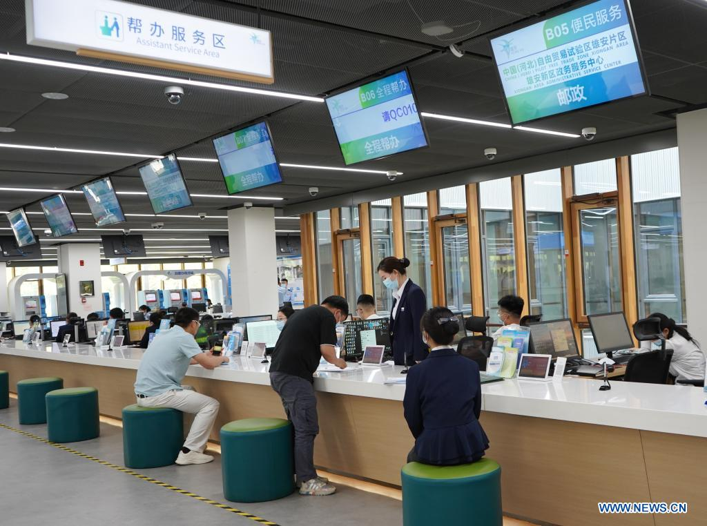 Staff members provide service for citizens at the assistant service area of the Xiongan New Area Administrative Service Center in Xiongan New Area, north China's Hebei Province, May 12, 2021. Founded on May 30 of 2018 and composed of different functional areas, the Xiongan New Area Administrative Service Center acts as a
