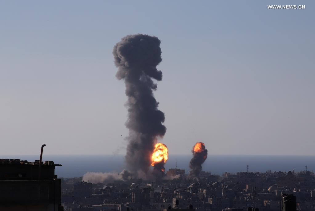Photo taken on May 13, 2021 shows explosions following Israeli airstrikes in the southern Gaza Strip city of Rafah. Thursday was another day of intense fighting between Israel and Hamas, as more than 1,700 missiles have been fired from the Gaza Strip into Israel in the last three days while the Israeli military has conducted hundreds of airstrikes in Gaza. (Photo by Khaled Omar/Xinhua)