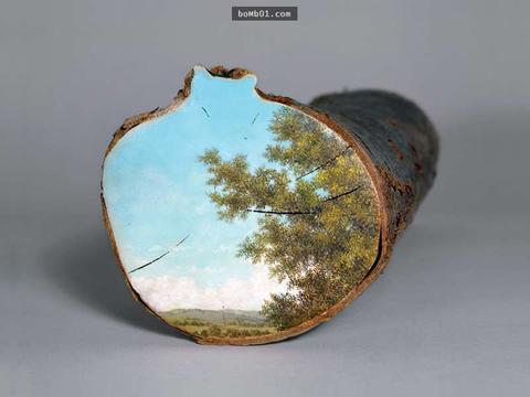 她在倒下的树干断面上作画,只为了祈求人类能够停止过度砍伐树木
