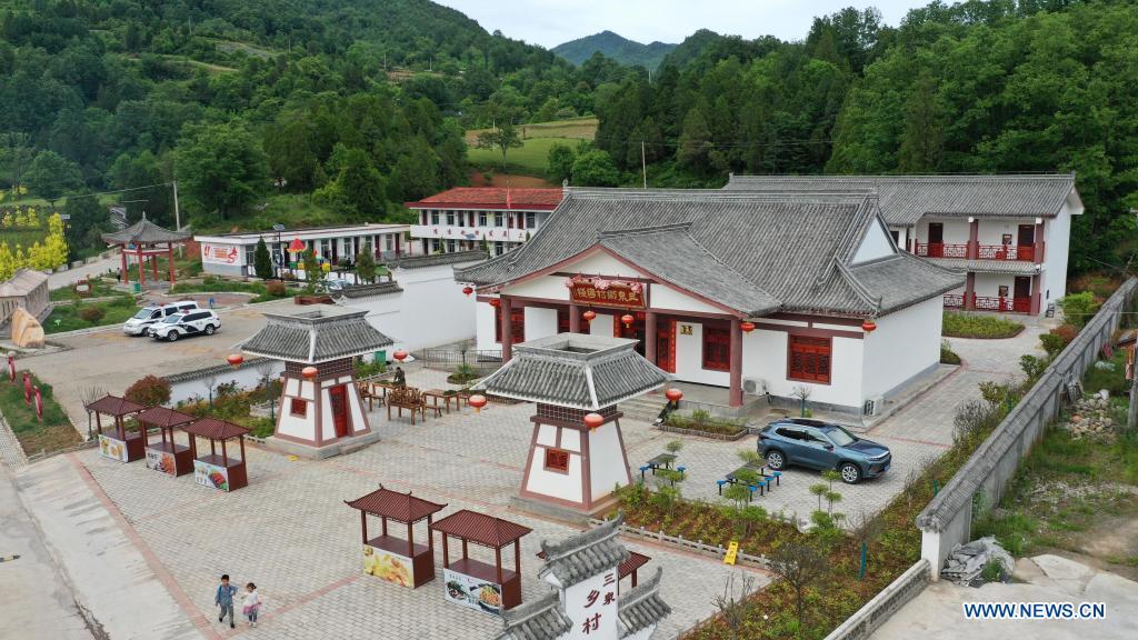 Aerial photo taken on May 19, 2021 shows a homestay in Sanquan Village of Huixian County, Longnan City, northwest China's Gansu Province. (Xinhua/Chen Bin)