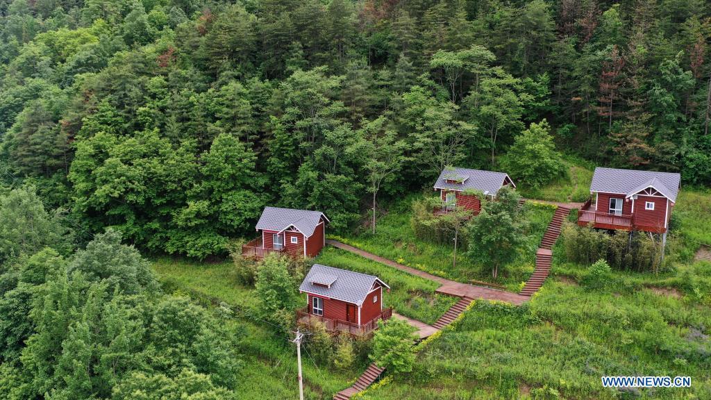 Aerial photo taken on May 20, 2021 shows cabins in Huaqiao Village of Kangxian County, Longnan City, northwest China's Gansu Province. (Xinhua/Lang Bingbing)