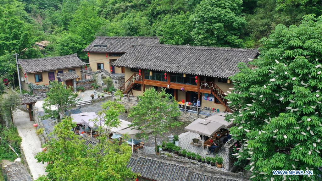 Aerial photo taken on May 21, 2021 shows a homestay in Zhujiagou Village of Kangxian County, Longnan City, northwest China's Gansu Province. (Xinhua/Chen Bin)