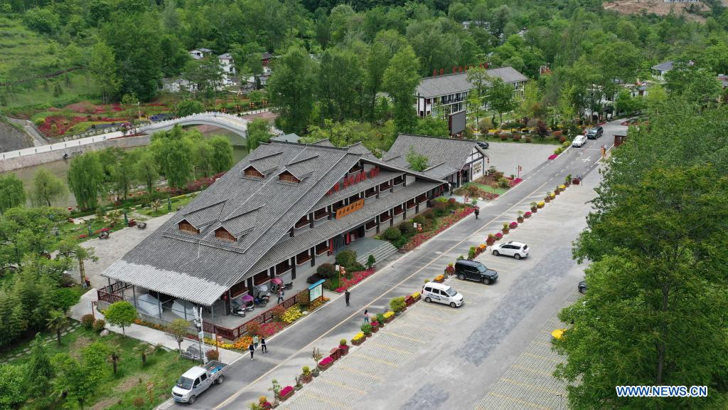 Aerial photo taken on May 20, 2021 shows the tourist center of Huaqiao Village, Kangxian County, Longnan City, northwest China's Gansu Province. (Xinhua/Chen Bin)