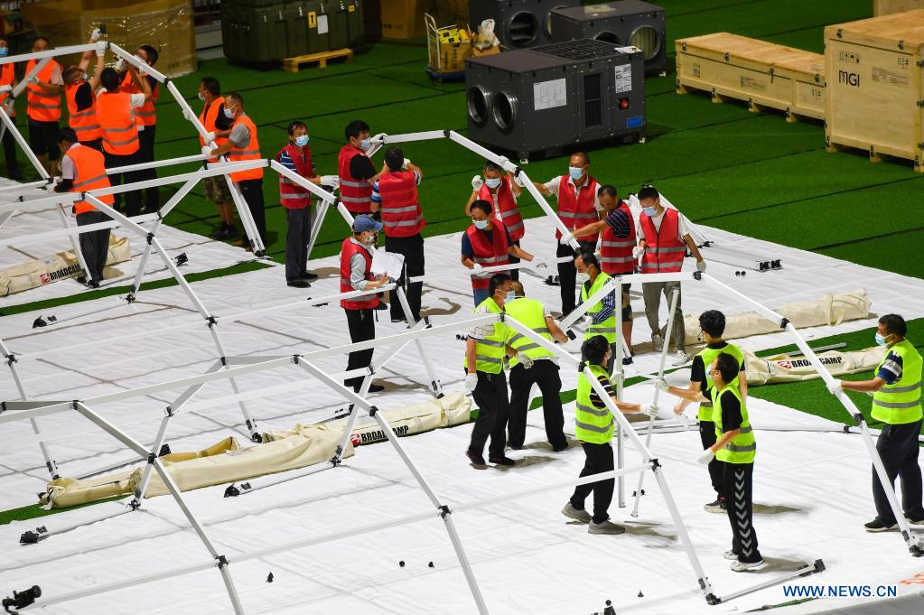 Builders set up temporary laboratories for nucleic acid testing in a stadium in Guangzhou, capital of south China's Guangdong Province, June 1, 2021. Four nucleic acid testing laboratories, with each unit covering an area of 210 square meters, were erected in early morning on June 2, and are about to put into use on June 3. The laboratories are able to test over 120,000 samples a day, which will significantly improve the city's testing capability. (Xinhua/Liu Dawei)