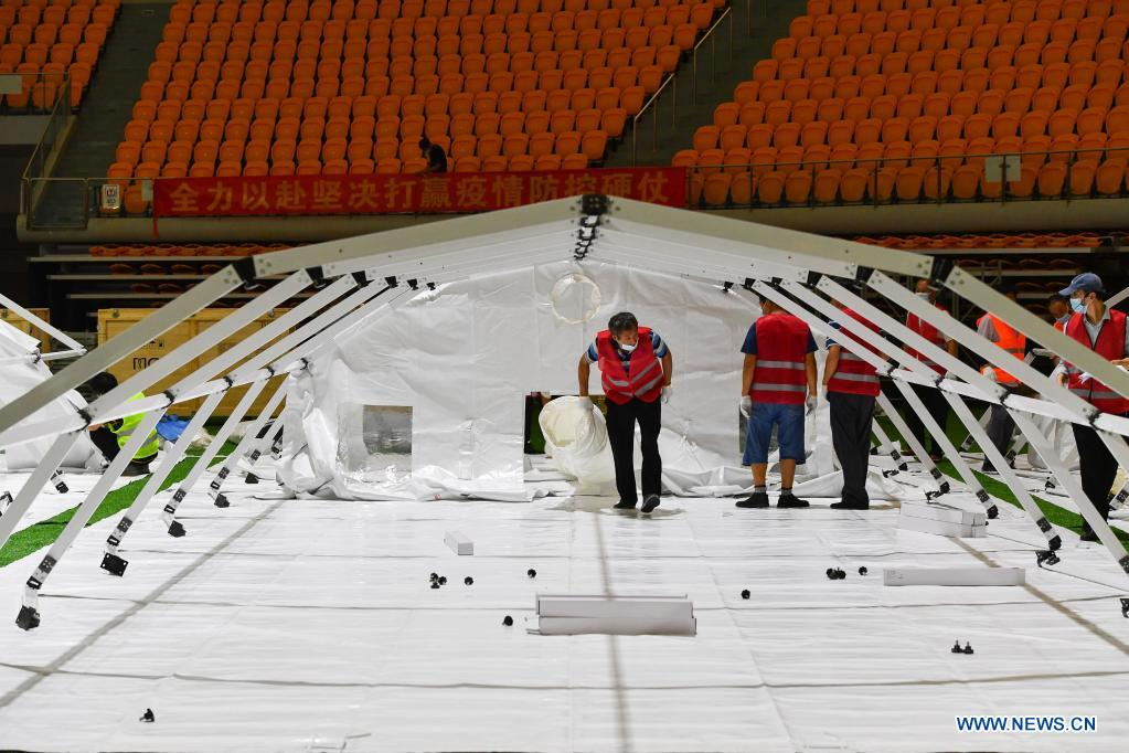Builders set up a temporary laboratory for nucleic acid testing in a stadium in Guangzhou, capital of south China's Guangdong Province, June 1, 2021. Four nucleic acid testing laboratories, with each unit covering an area of 210 square meters, were erected in early morning on June 2, and are about to put into use on June 3. The laboratories are able to test over 120,000 samples a day, which will significantly improve the city's testing capability. (Xinhua/Liu Dawei)