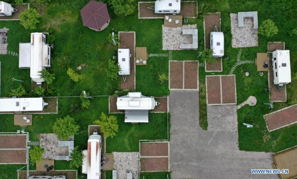 Aerial photo taken on May 20, 2021 shows an RV camp in Huaqiao Village of Kangxian County, Longnan City, northwest China's Gansu Province. (Xinhua/Chen Bin)